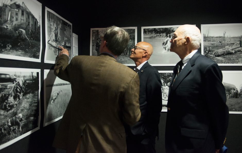 Berkley, Hudson, Jim Turner and Mike Middleton looking at old photographs.