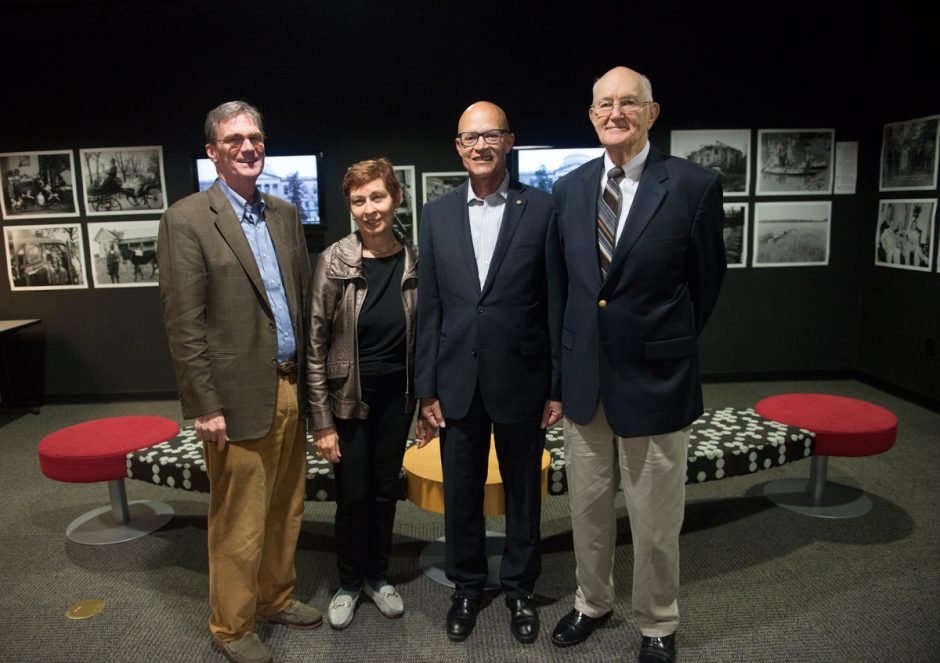 Berkley Hudson, Anita Stephens, Mike Middleton and Jim Turner in the center of the photo exhibit