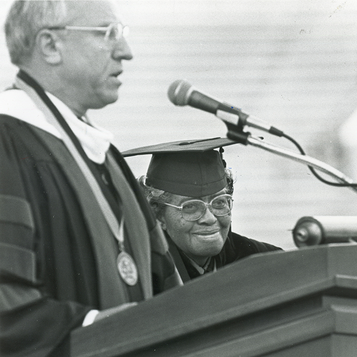Lucille Bluford smiles as she is honored at a commencement ceremony.