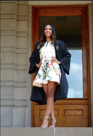 This is a picture of Chloe Cameron in her graduation robe in front of Jesse Hall