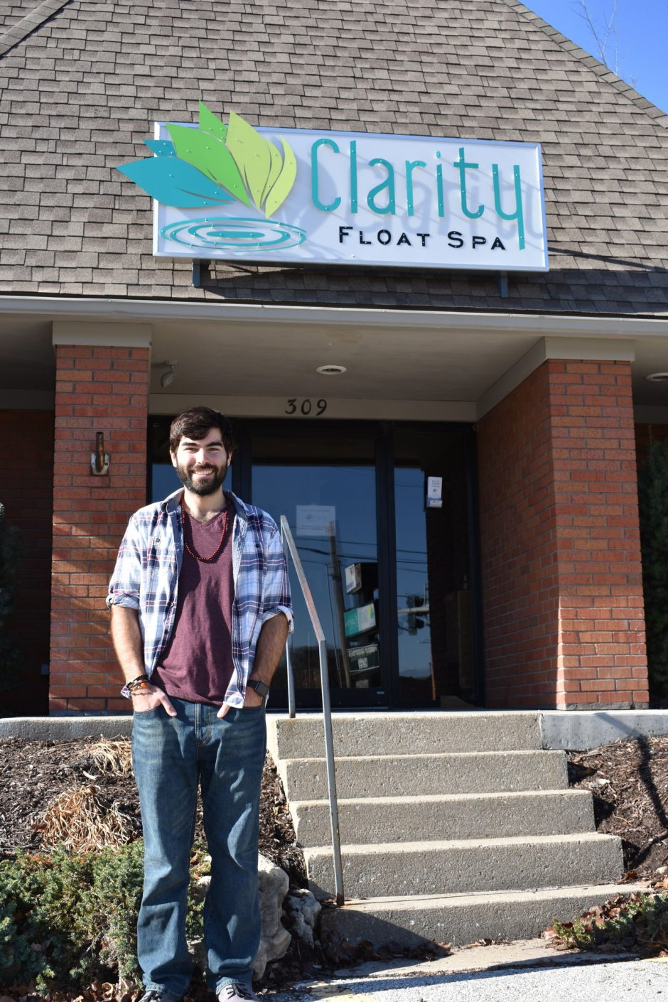 Picture of Connor Knabe standing in front of Clarity Float Spa in downtown Columbia
