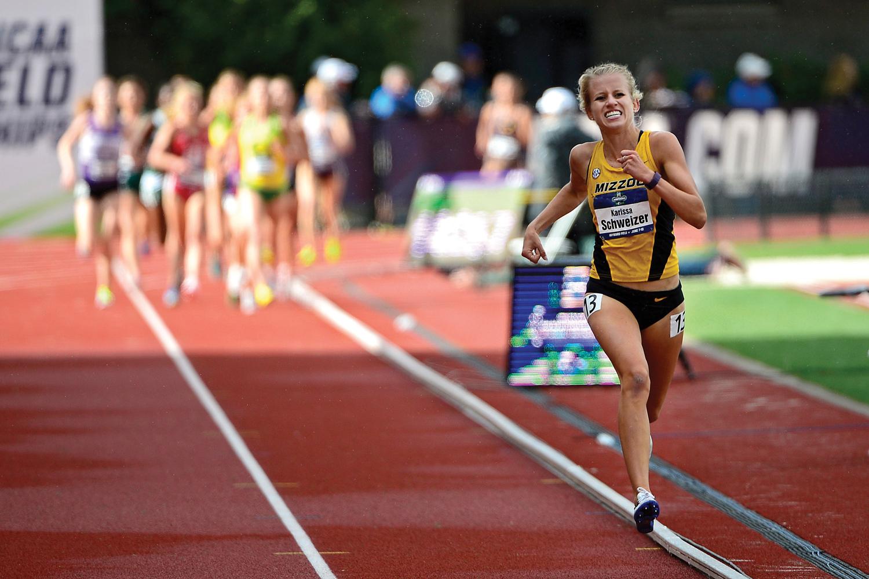 female athlete running.