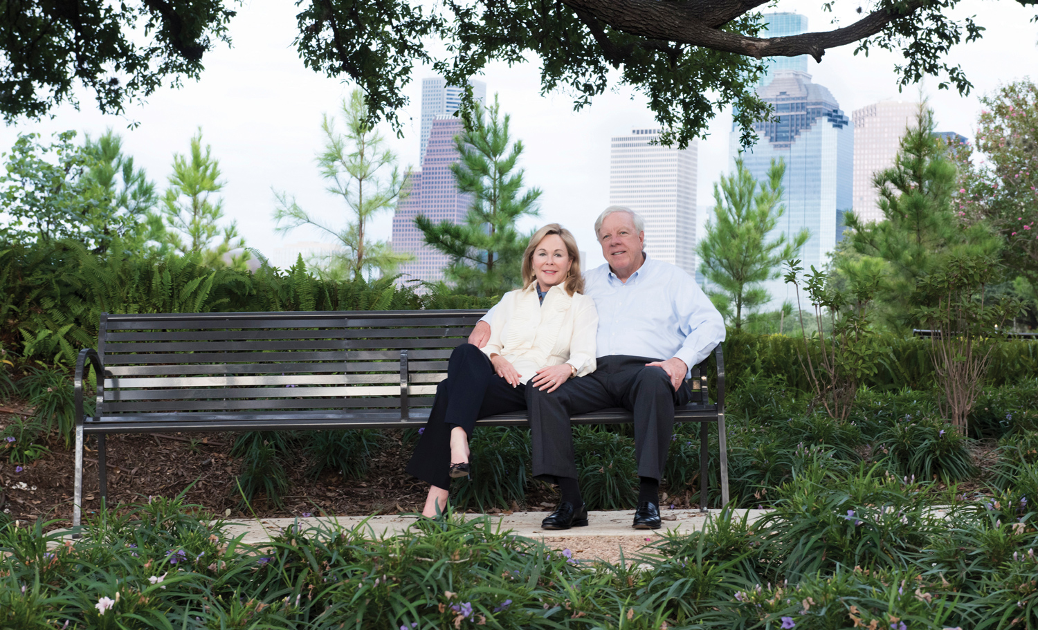 Rich and Nancy Kinder sitting on bench
