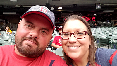 This is a picture of Jennifer Foster and her husband at a Cardinals game