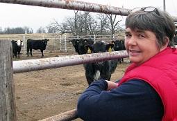 Imogene Hemeyer Latimer in front of a cattle herd