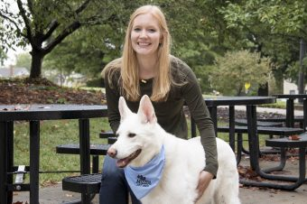 This is a picture of Lauren Panasevich with a white dog