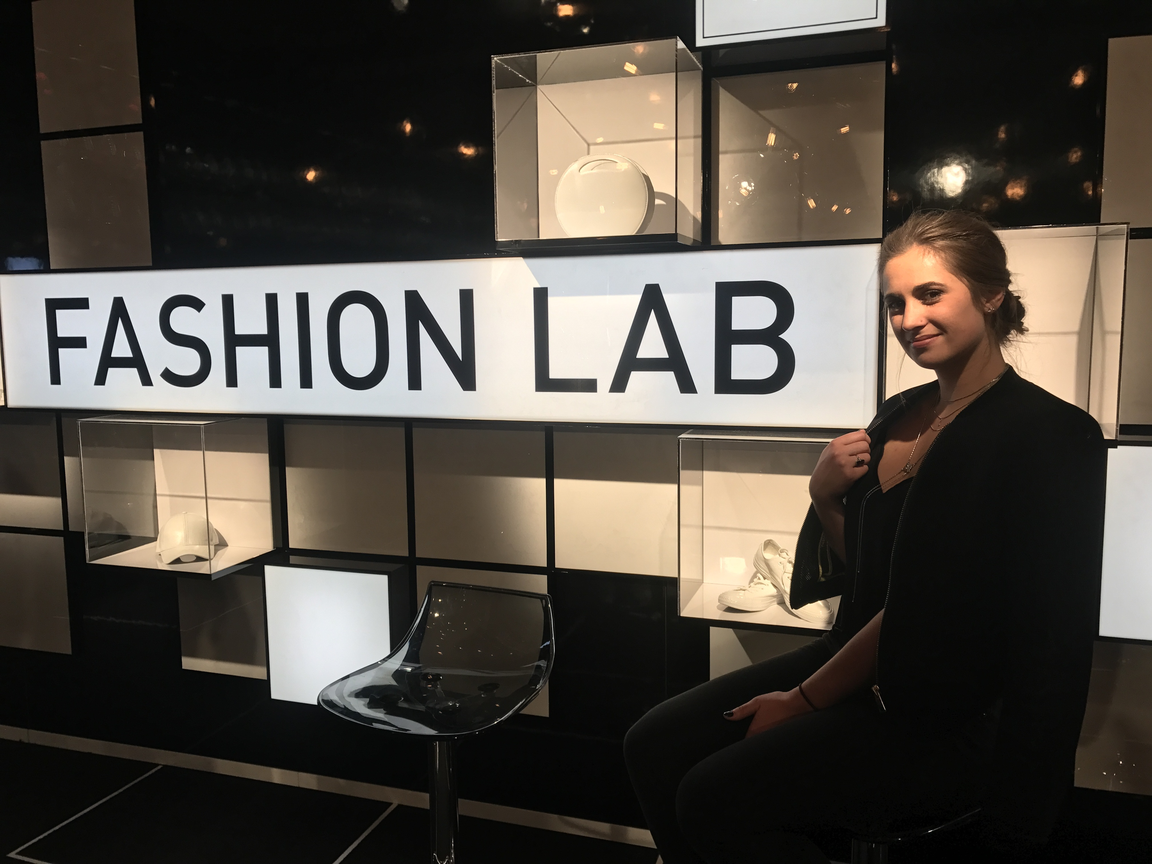 This is a picture of Mackenzie Mattix in front of the Fashion Lab in NYC