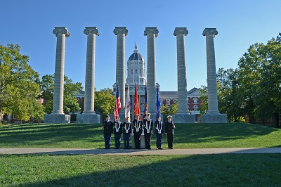 This is a picture of ROTC members in front of Jesse Hall and the Columns