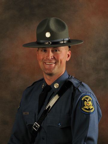 Picture of Travis Inman in his old Highway Patrol uniform