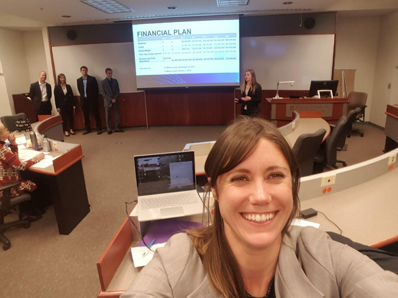 This is a picture of Maria Magner in a conference room before a College of Business Event