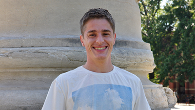 This is a picture of Samuel Richards in front of the Mizzou columns