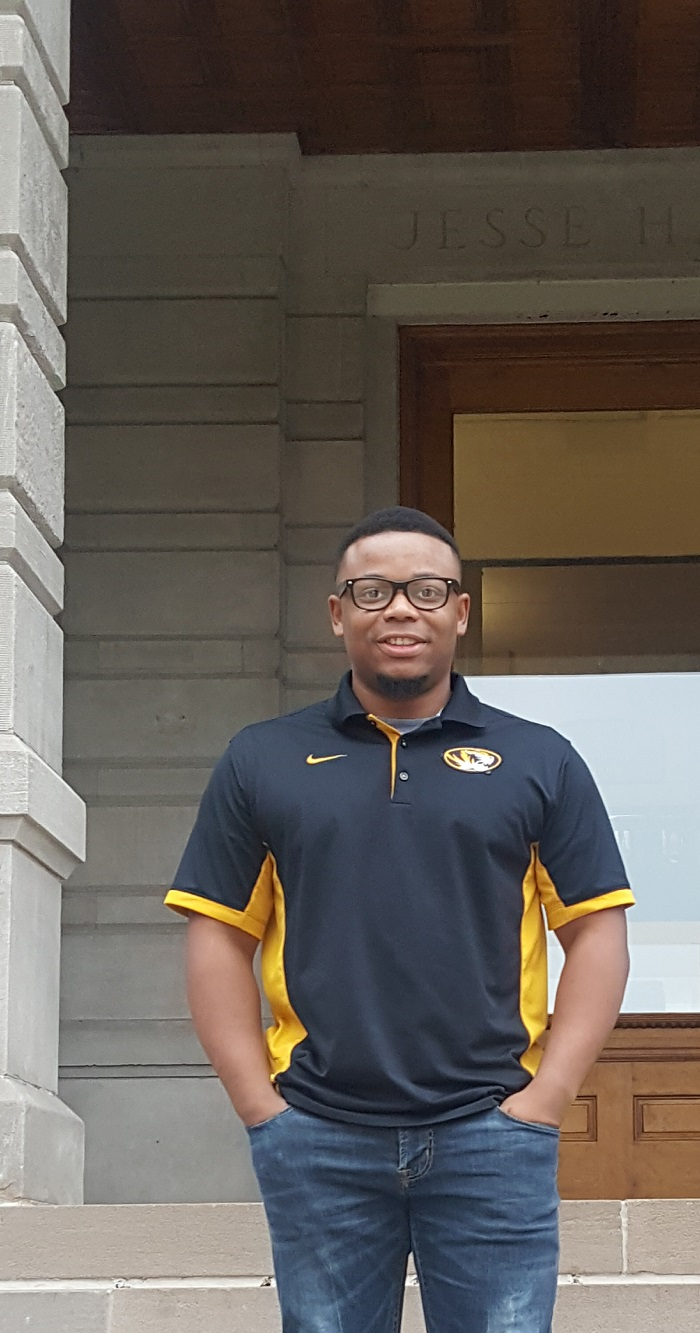 This is a picture of Rico Atkins in front of Jesse Hall
