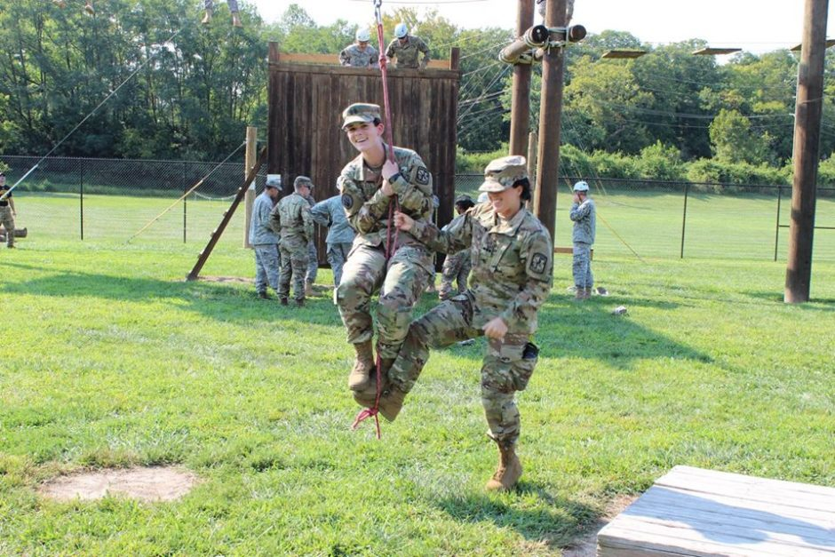 ROTC cadet Emily Campbell gets an assist from cadet Nicole Futch during training exercises.