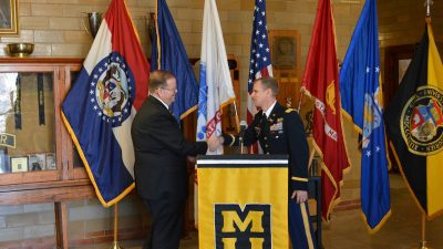 This is a picture of Chancellor Cartwright and Lt. Col. Kerr shake hands after announcing the new ROTC scholarships announcing room and board for incoming ROTC students.