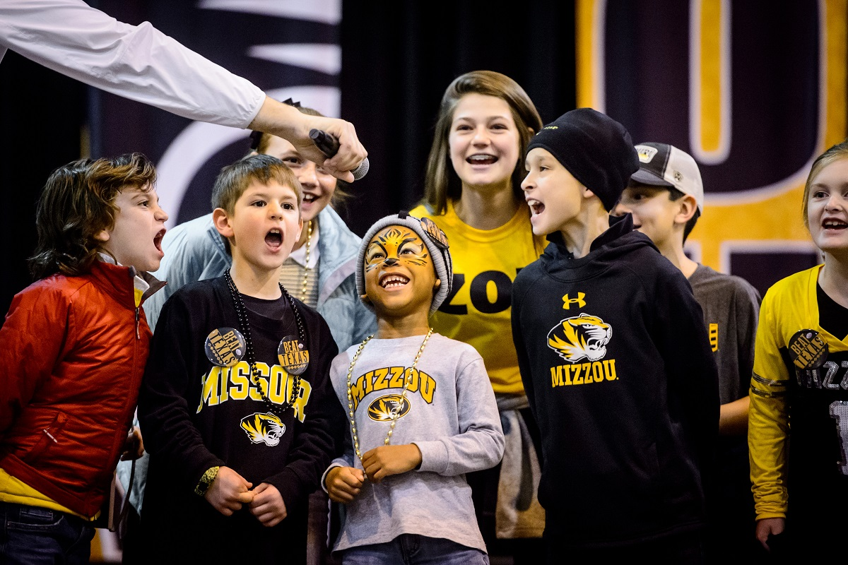 Five-year-old David Overstreet, III, with faceprint, son of Chelsea Brooks ('08) and David Overstreet, II, leads an M-I-Z cheer with other children during the Mizzou Alumni Association Tiger Tailgate before the Texas Bowl at NRG Stadium in Houston, Texas, on Wednesday, Dec. 27, 2017.