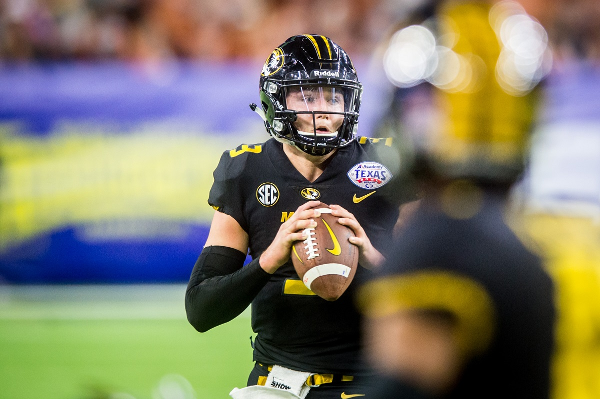 Missouri Tigers quarterback Drew Lock (3) drops back to pass.