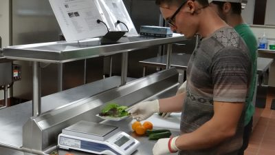 This is a picture of ramiro Arreola working in the MU dietetics lab