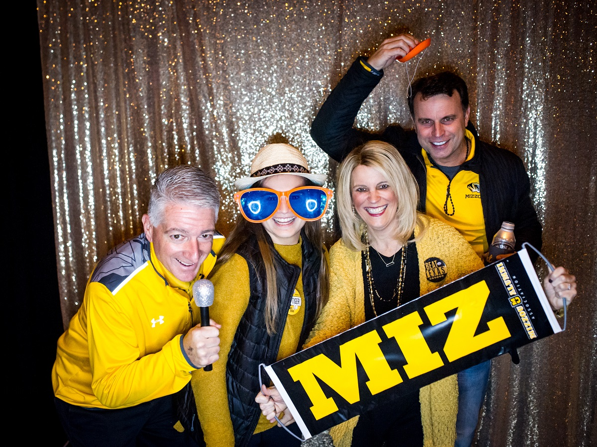 Ray Boccardi ('90), Carly Boccardi, Kristi Boccardi ('91) and Brian Pawblowicz ('89) take a photo booth picture during the Mizzou Alumni Association Tiger Tailgate before the Texas Bowl at NRG Stadium in Houston, Texas, on Wednesday, Dec. 27, 2017.