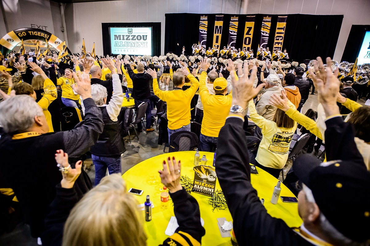 Fans participate in the Missouri Waltz led by Marching Mizzou and spirit squads during the Mizzou Alumni Association Tiger Tailgate before the Texas Bowl at NRG Stadium in Houston, Texas, on Wednesday, Dec. 27, 2017.