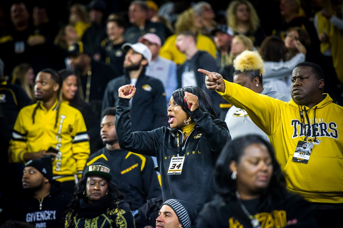 Benita Rountree and Larry Rountree II cheer from the stands.