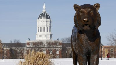 This is a picture of the Tiger statue at Tiger Plaza with Jesse Hall in the background