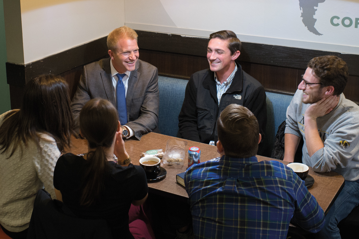 This is a picture of Thom Lambert enjoying coffee and laughter with his law students.