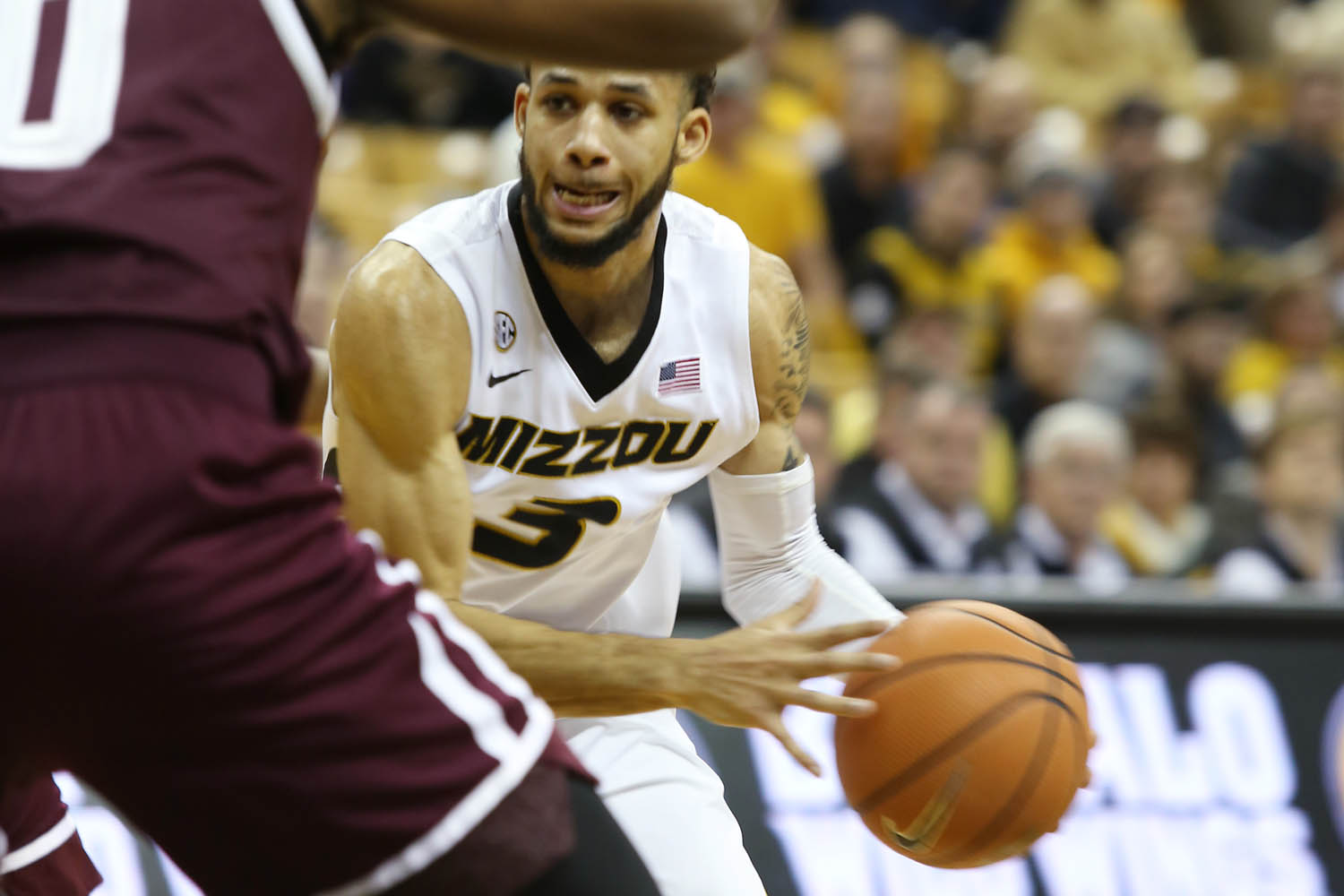 Guard Kassius Robertson dribbles the ball down the court.