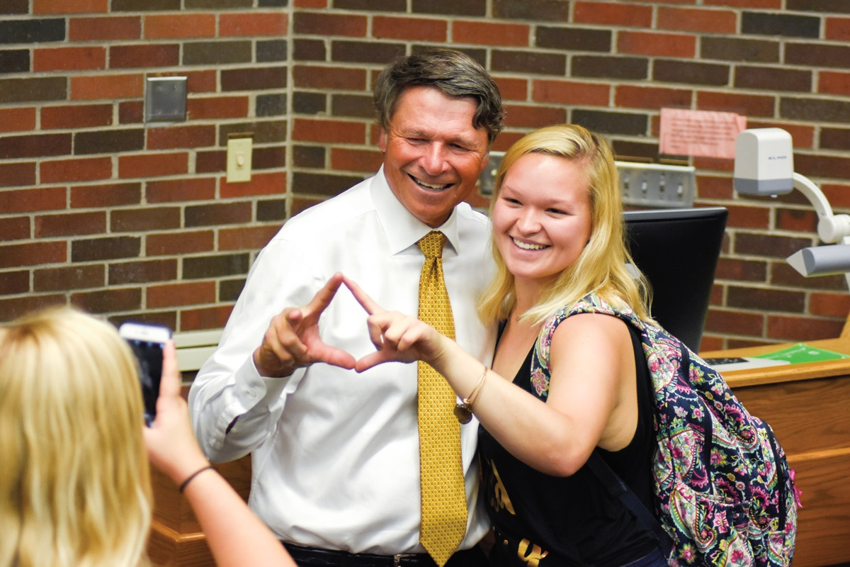Novak poses with student Amy Hanks after delivering a guest lecture to a Principles of Strategic Communication class.