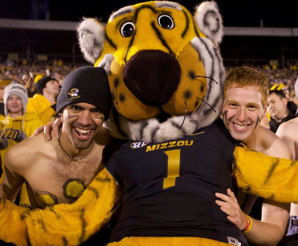 Fares Akremi, Truman the Tiger and a friend decked out in Black and Gold at a Mizzou Football game