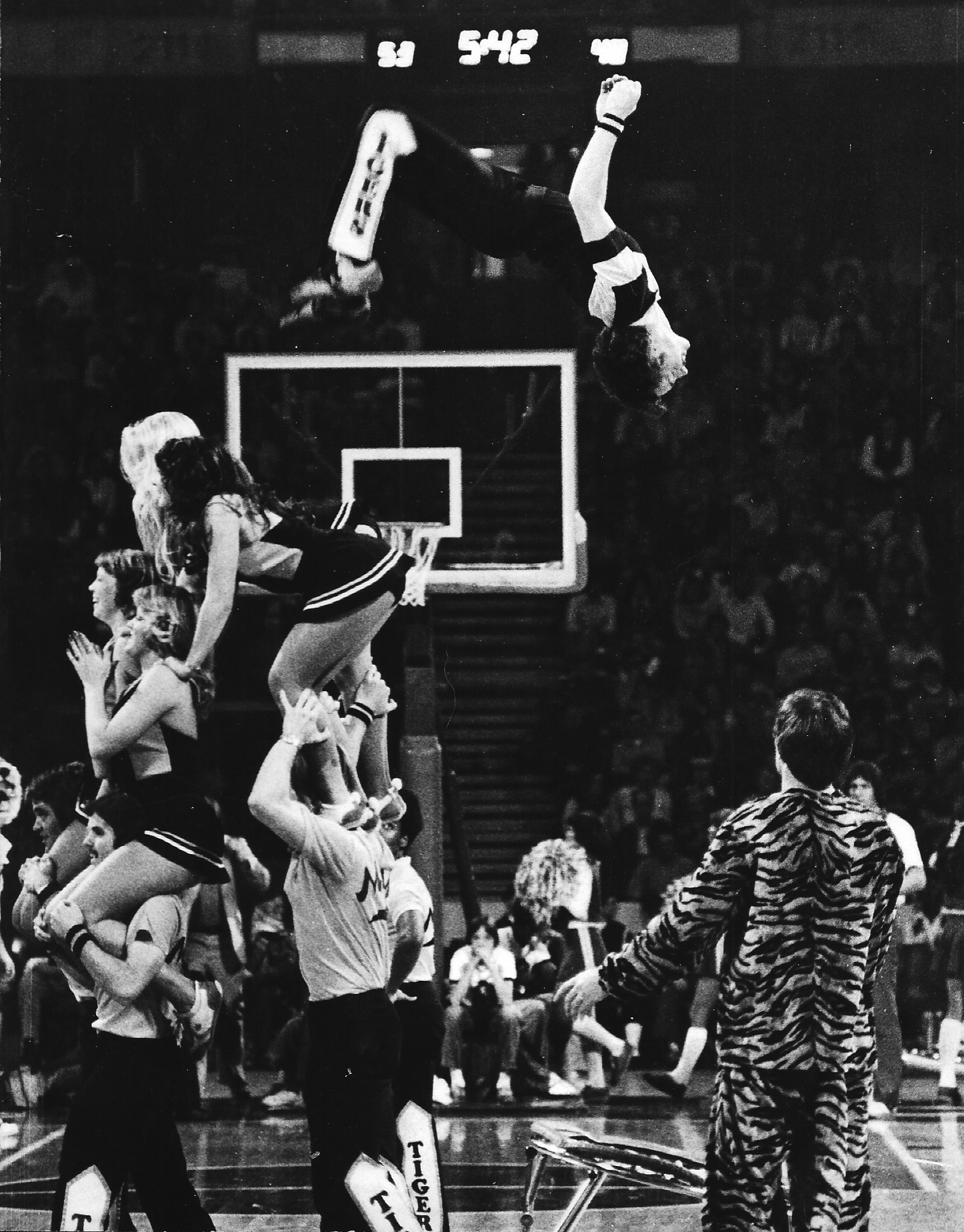 Picture of Jess Bushyhead doing a back flip at the Hearnes Center as a Mizzou Cheerleader in the late 1970s