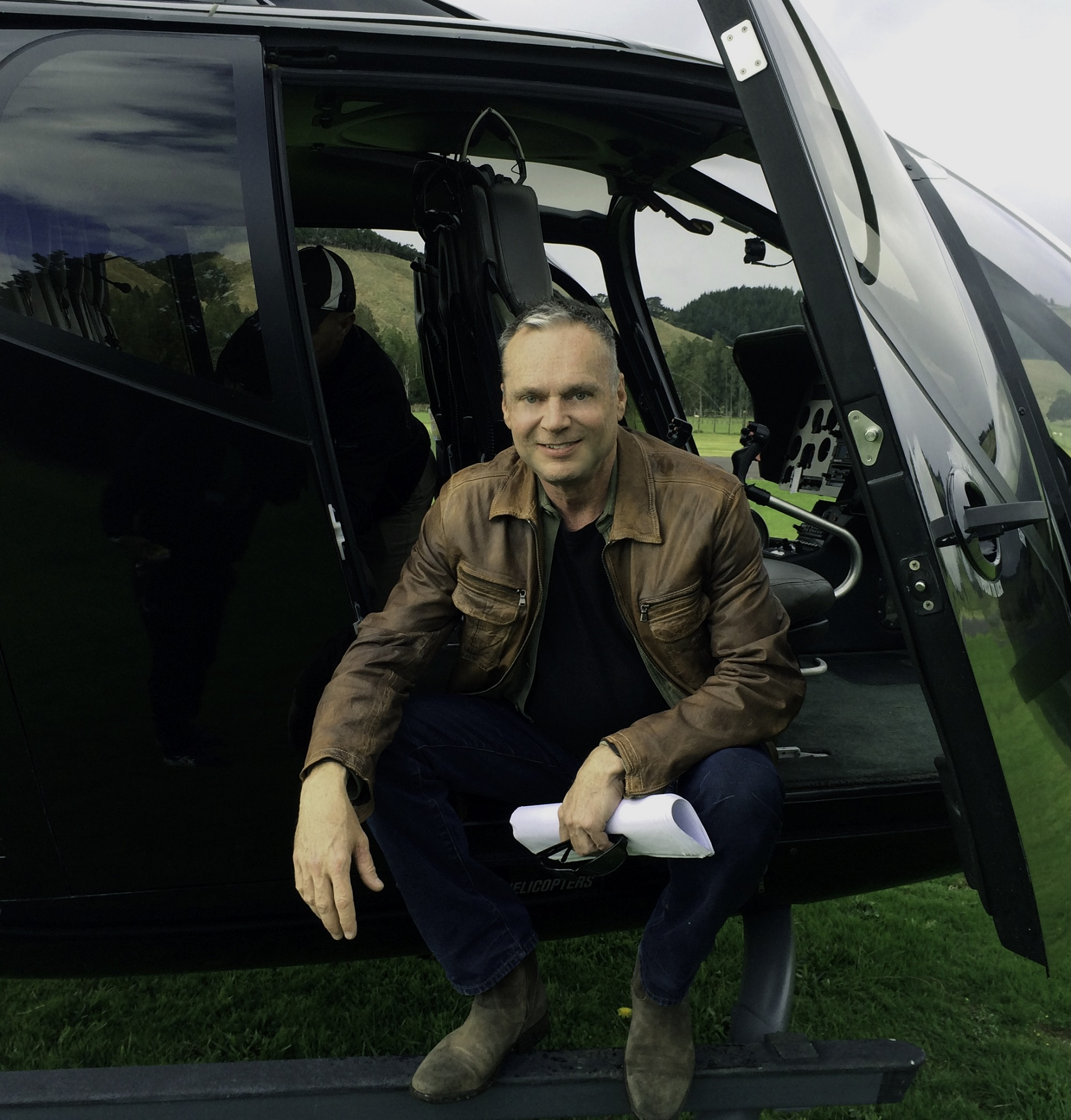 Picture of Jess Bushyhead in a helicopter after a tour in New Zealand.