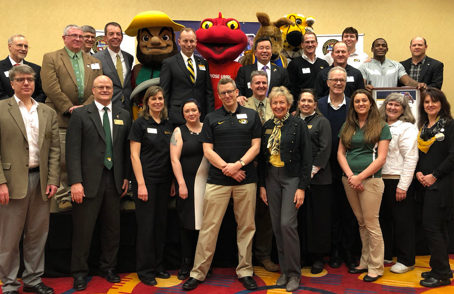 The Presidential Engagement Fellows represent all four campuses of the University of Missouri System. This is a picture of all the fellows with President Choi and the four mascots.