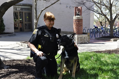 This is a picture of MUPD officer Joan with German Shepherd Brass in front of the MU Student Center