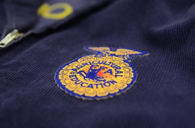 This is a picture of a FFA badge on a blue jacket.