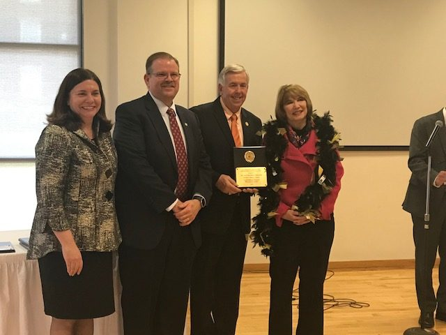 Kathryn Chval, dean of the College of Education, Chancellor Alexander N. Cartwright and Lt. Governor Mike Parsons presented Kathleen Unrath, associate professor of arts education, with the 2018 Governor's Award for Excellence in Teaching.