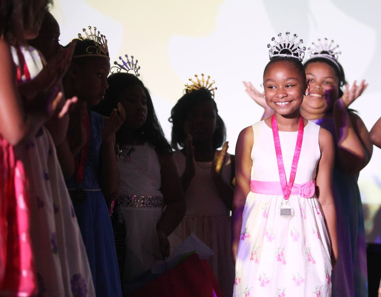 Aleena Simmons smiles as she is announced the third annual Little Miss Elite.