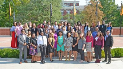 This is a group photo of MCAC college advisers on Traditions Plaza in front of Jesse Hall