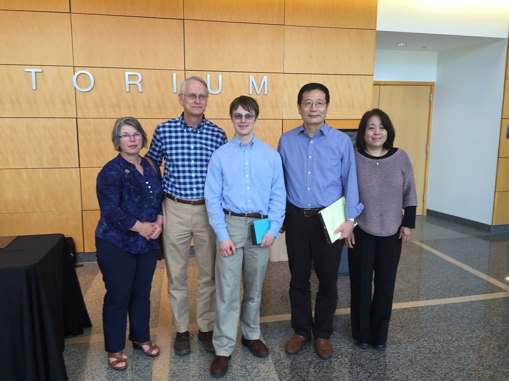 Picture of Eric Prullage and his parents and Dr. Zhang and his wife.