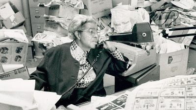 In this Missourian archives file photo from Feb. 1, 1989, Lucile Bluford answers phones while working at the Kansas City Call.