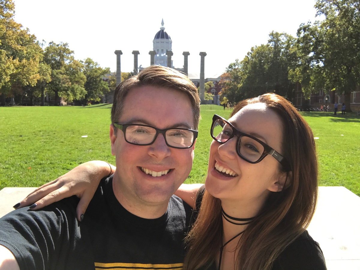 Picture of Greg Miller and his wife in front of Jesse Hall and the Columns