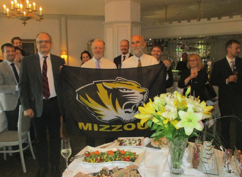 Picture of Dean Rikoon presenting a Mizzou flag to Czech higher education leaders