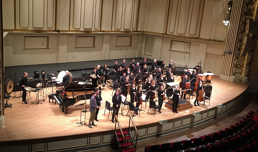 St. Louis symphony practicing on stage.