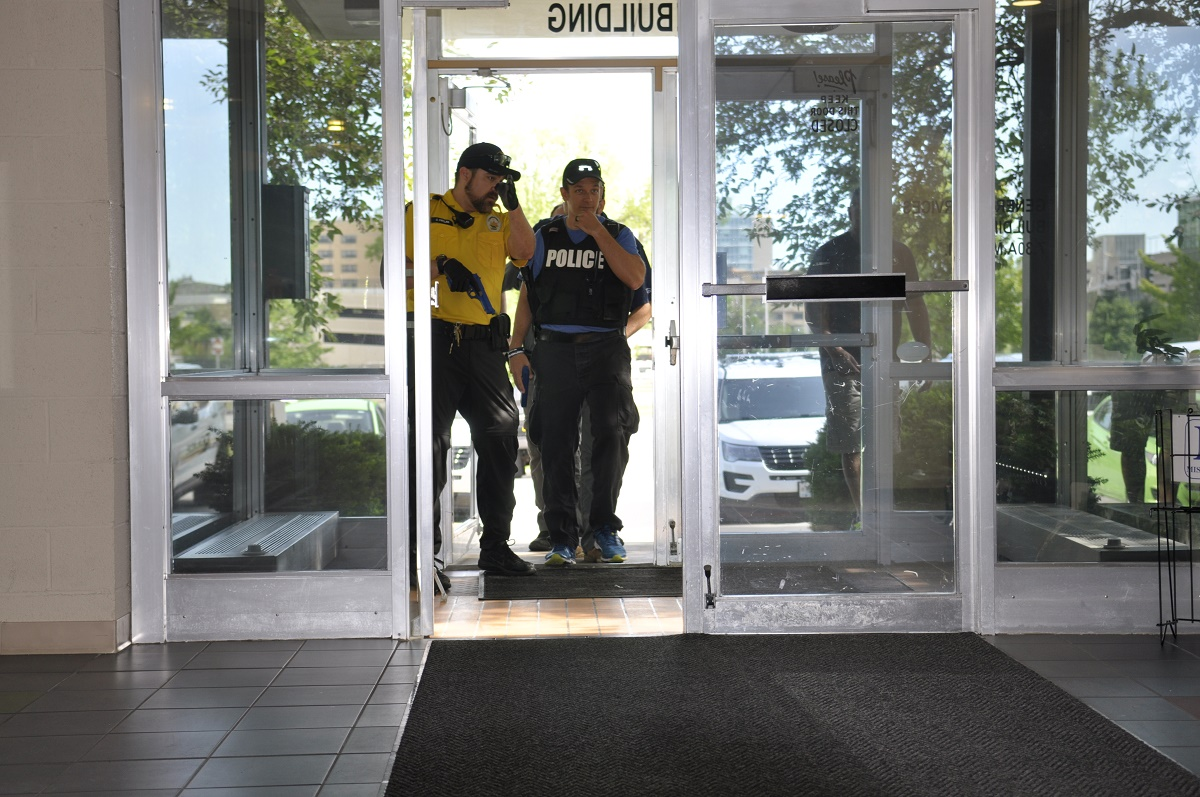 This is a picture of University of Missouri police officers Justin Patlan, left, and Dustin Heckmaster enter the General Service Building during a recent daylong active threat training on campus.