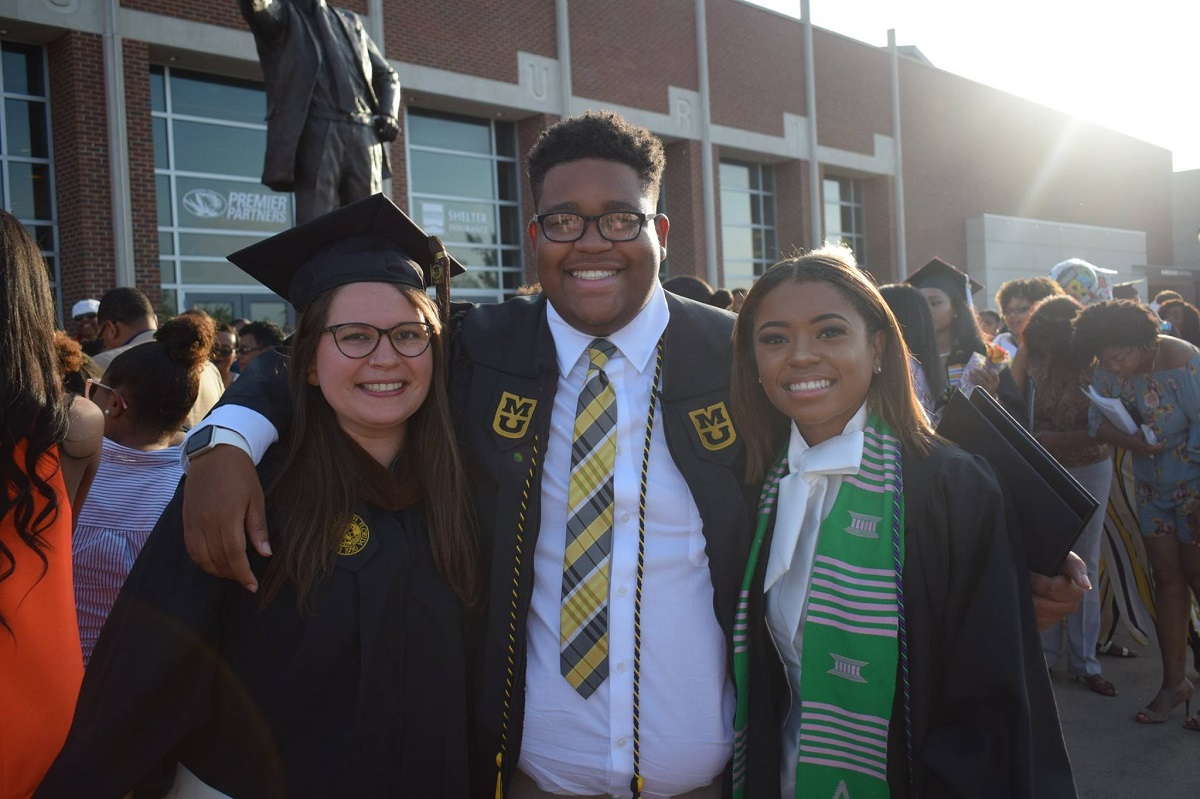 This is a picture of Eichel Davis and friends during Mizzou's commencement outside Mizzou Arena.