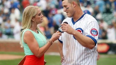 This is a picture of Kelly Crull interviewing Anthony Rizzo of the Chicago Cubs
