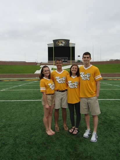 Picture of Natalie Edelstein on Faurot Field with other Summer Welcome leaders