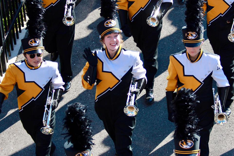 This is a picture of Rachel Grayson in her Marching Mizzou uniform getting ready to enter Memorial Stadium.