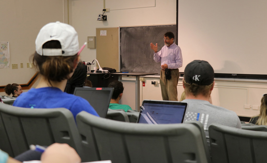 Dr. Smith speaks to students in a genetics class