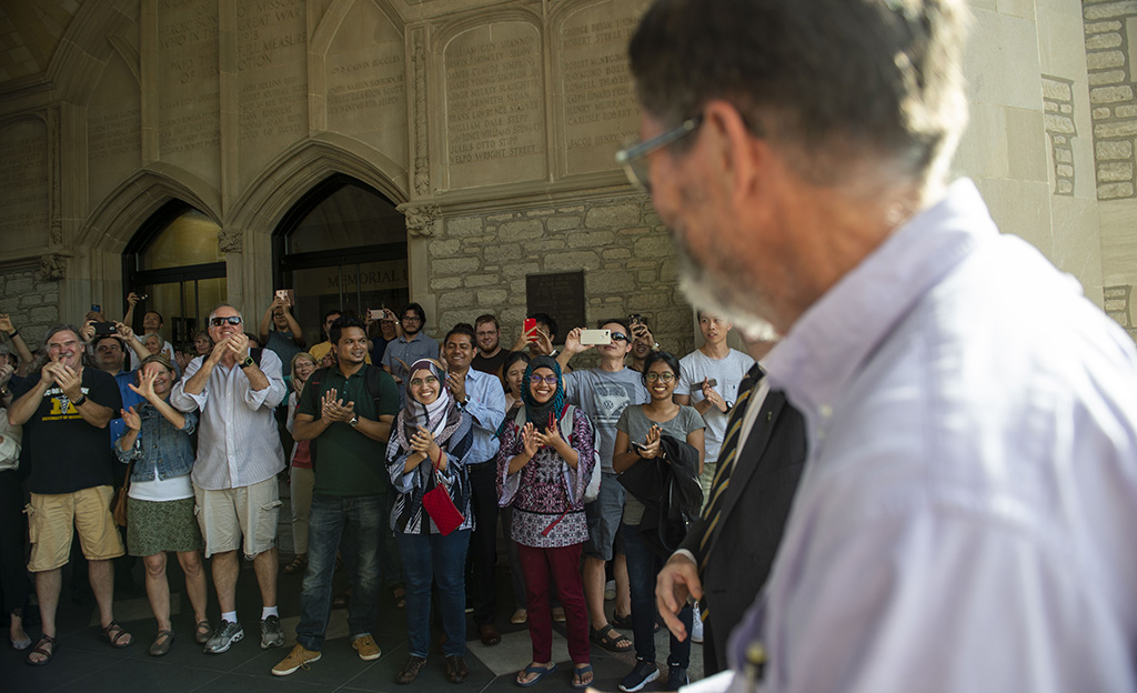 A cheering crowd of supporters greets Dr. Smith as he approaches Memorial Union where the celebration was held.