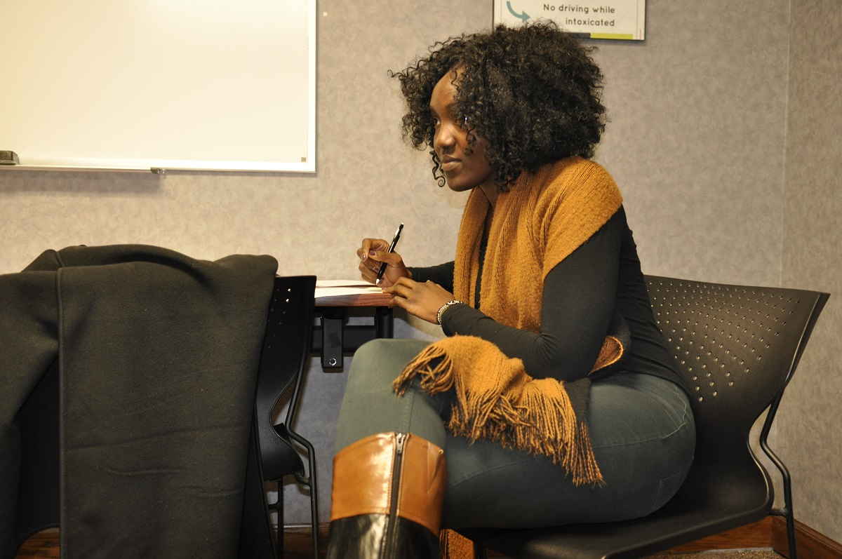 This is a picture of Robina Onwonga, a doctoral student in counseling psychology, working in the clinic